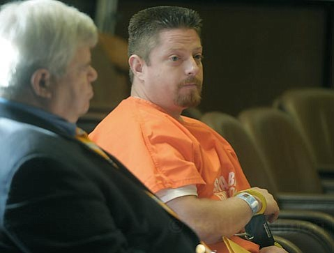 Steven Cisneros, at his sentencing for the 2009 murder of Lawrence Kaiser, listens to testimony from the victim's father.