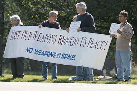 Protestors gather in front of Vandenberg Air Force Base on Sunday.