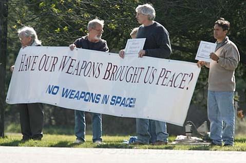 Protestors gather in front of Vandenberg Air Force Base on Sunday.