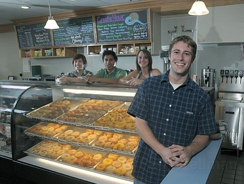 Ultimate Bagel owner Alex Weinstein (foreground) gets help from Samantha, Gerson, and Sara (behind counter, from left) in his State Street shop, which has been open since last November.
