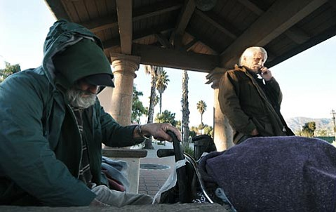 <strong>Cost offset:</strong>  Prodded by activists concerned that seven homeless people have died in as many weeks—plus 28 last year—the county supervisors scrounged up $40,000 to help defray costs incurred by South Coast churches that have opened their doors as emergency warming centers during the winter rains.
