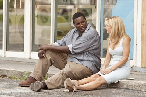 Sandra Bullock with Quinton Aaron in <em>The Blind Side</em>