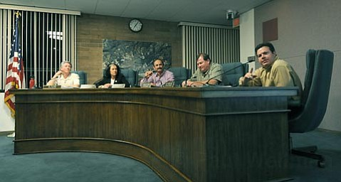 <strong>Heckled:</strong>  Carpinteria City Councilmember Joe Armendariz (right) soliloquized and agonized about Measure J, the Venoco-sponsored oil initiative that would allow an expanded oil and gas plant behind City Hall. The rest of the council opposed the measure, but by night's end, Armendariz declined to take a position.