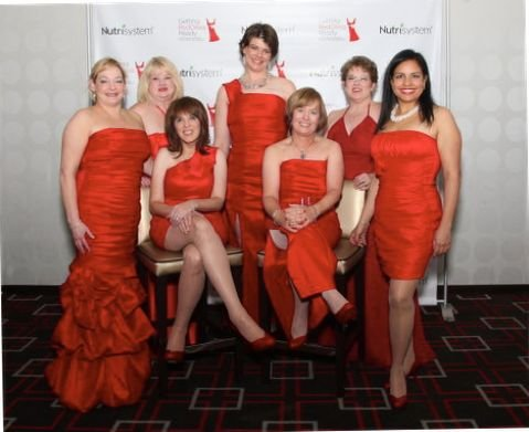 SBCC professor Evan McCabe, sitting right, traveled to New York for National Wear Red Day.