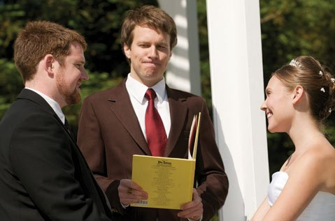 <em>Indy</em> copy editor Amy Smith and husband Mike Smith are married by officiant/best friend David Priddy.