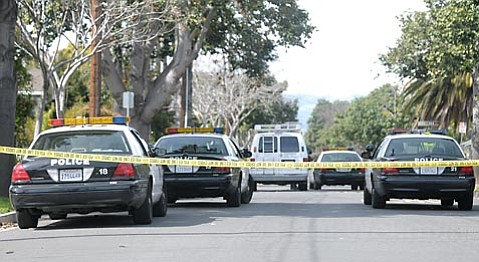 Police cars on the 1500 block of Gillespie St. investigate a late morning shooting Mar. 1, 2010