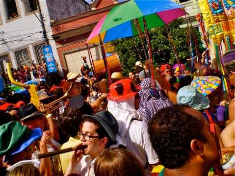 People crowd into the neighborhood of Santa Teresa at 8:00 a.m. to party.
