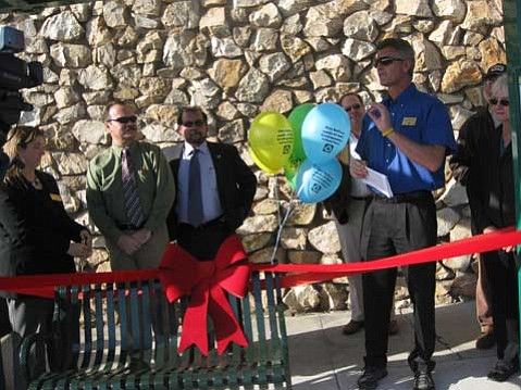 Goleta Mayor Eric Onnen and other dignitaries gather on March 8 to celebrate Goleta's new bus shelter.