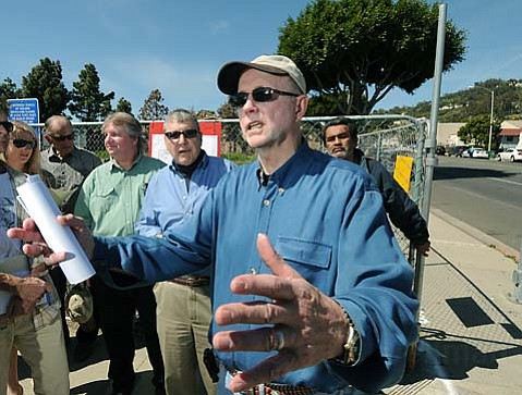 <strong>CULTURE WARS:</strong> Jim Westby (right) and Rick Feldman (to his right) will take their complaint against a bulb-out proposed for the Milpas Street speedway to the City Council next week.