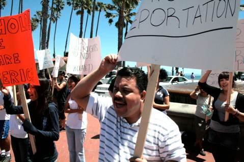 Around 50 protestors gathered at the dolphin fountain on Saturday to protest Arizona's new law - the toughest in the nation - that targets illegal immigrants.