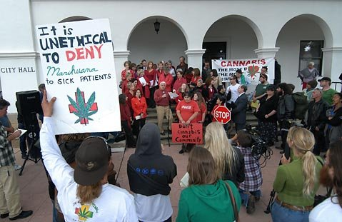 <strong>REEFER MADNESS:</strong>  There was definitely more heat than light shed as the dueling medical marijuana clans clashed outside S.B. City Hall Tuesday night. Inside, however, the councilmembers managed to fashion a compromise package that garnered the five-vote supermajority needed to pass.