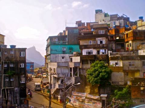 The tightly packed homes at the very top of Rocinha frame Rio's famous statue Cristo Redentor in the background.