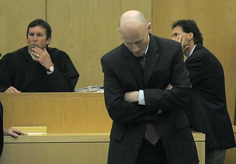 Hans Almgren leaves a sidebar with Judge Brian Hill and the defendants' attorneys on July 6, 2010 with a mistrial looming on three of the five counts.