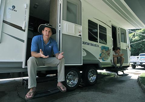 """<strong>MAD ABOUT MISINFORMATION:</strong>  When Jason Kimbrell (pictured left, with working partner James Ware) brought his Vacation Trailers 2 U (VT2U) to town and won the permit to deliver RVs to state parks in S.B. County, he had no idea that Earl's RV of Lompoc had been doing the same service for 20-plus years. But after jumping through the correct hoops and earning the exclusive right to do business at El Capitán, Refugio, and other beaches, Kimbrell is now angry that Earl's RV owner Brad Pellegrin (who did not return requests for a photograph) is painting VT2U out to be the bad guys. """"I'm still referring customers to Earl's and the guy has never even responded to calls,"""" said Kimbrell, who also went to make peace with Pellegrin in person. """"It's just so backward."""""""