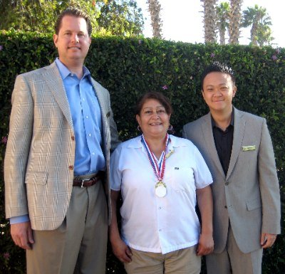 Resort General Manager Matthew LaVine; Award Winner Gloria Dominguez and Director of Rooms Benjamin Ly