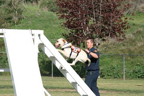 Eric Gray training his rescuedog, Riley.