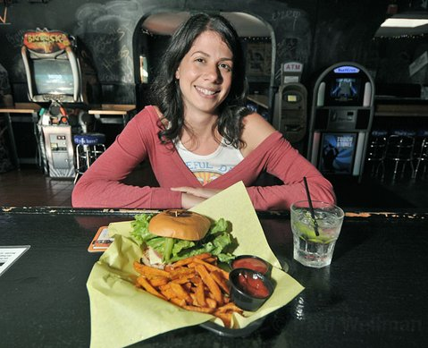 Happy hour fans include Kim, who takes her turkey burger and sweet potato fries with vodka and soda.