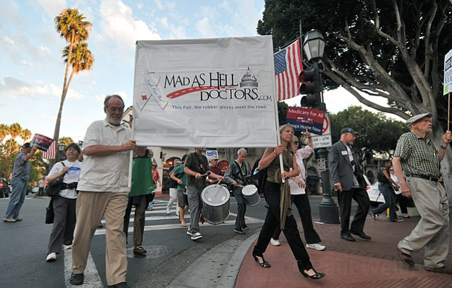 A group of 50 marchers teaming with Mad as Hell Doctors protest on State Street Sept. 30, 2010