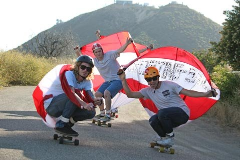 <strong>The Sporting-Sails crew:</strong>  (from left)  Ryan Dafoe, C.J. Vallely, and Billy Smith demonstrate the magic of  their flying squirrel-style parachute as they descend a mountain road  above Santa Barbara.