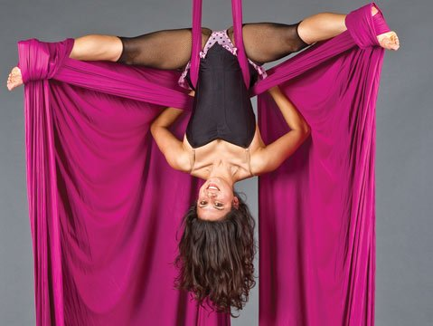 Right-side up or upside-down, Ninette Paloma teaches youths and adults how to fly at La Petite Chouette, her new aerial dance studio on Milpas Street.