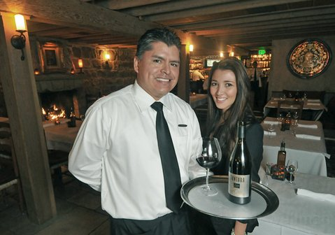 Plow & Angel server Agustin Franco (left) and hostess Jessica Lieberman.