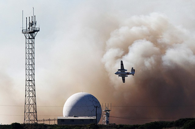 10/28/10  An aerial tanker flies past a tracking station neat Vandenberg Air Force's Solvang Gate while battling the Bear Creek Fire.