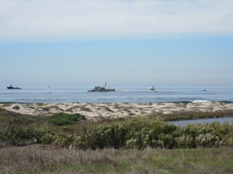 """From left to right, Clean Seas' skimming boat """"Clean Ocean,"""" tug boat """"Clean Sweep,"""" and boom boat """"Ajax"""". The barge, """"Jovalan,"""" is the large boat in the center."""