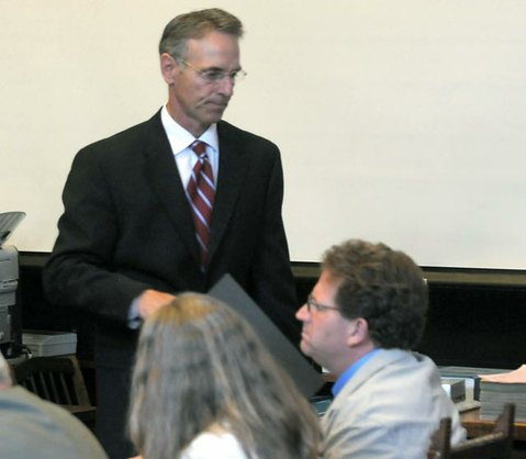 Senior Prosecutor Gordon Auchincloss (standing) has been calling people to the witness stand who testified Corey Lyons (seated) told them he wanted to kill his brother, Daniel Lyons, and how his brother was going to take everything he had as a result of a lawsuit (File photo 2009)