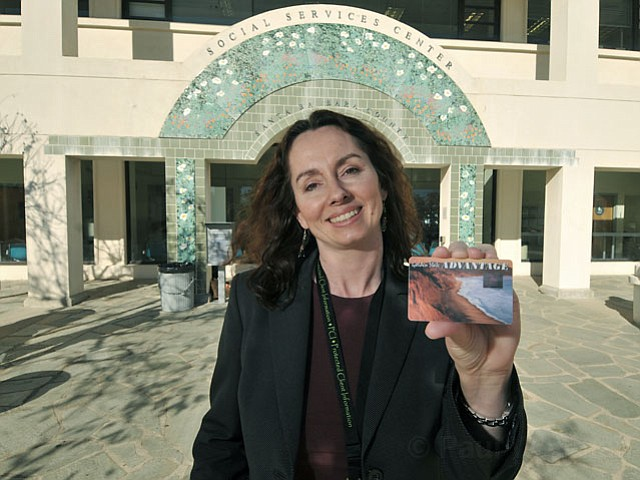 <strong>SO NOT STREAMLINED:</strong>  Maria Gardner, assistant deputy director for social services in S.B., is working on ways to simplify the process of receiving CalFresh benefits, formerly California's Food Stamp program. Gardner—here holding a food stamp card that replaced the old paper vouchers—and others estimate 36,000 people in S.B. County are eligible for food stamp benefits but are not receiving them partially because the process to qualify is so daunting and time-consuming.