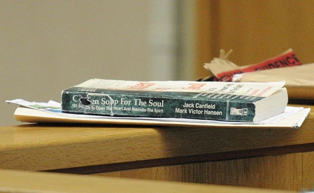 The <em>Chicken Soup for the Soul</em> book in which Donald Lee Bedford allegedly hid a camera. The device's lens can be seen peeking out of a small hole cut into the top part of the spine.