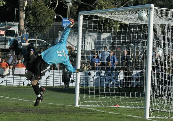 Akron's Scott Caldwell scores on Louisville in the second half of NCAA College Cup at UCSB Harder Stadium Dec. 12, 2010