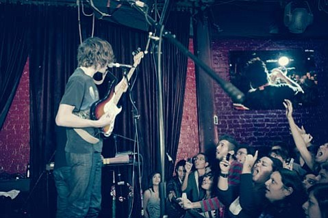 Tokyo Police Club's Dave Monks gives back to his fans during Friday's rockin' tour stop at Velvet Jones.