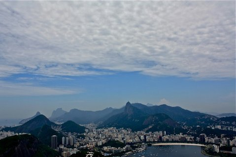 "This view of Rio de Janeiro from atop Pão de Açucar inspired my mom to compare the city's beauty to Paris, saying ""Paris is just architecture and a river. But look at all these mountains and rocks!"""
