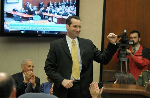 <strong>NEWBIE:</strong>  Steve Lavagnino, freshly minted 5th District Supervisor, raises a fist of triumph to a roomful of supporters and colleagues at Tuesday's swearing-in ceremony. Lavagnino replaces outgoing supervisor Joe Centeno on the board.