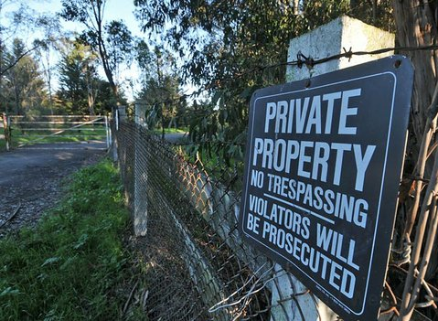 The locked gate on Dos Pueblos Canyon Road that leads to the Naples property in Goleta, CA