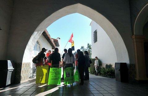 Members of AIM Santa Barbara gather outside the Arlington Theater on MLK Jr. Day