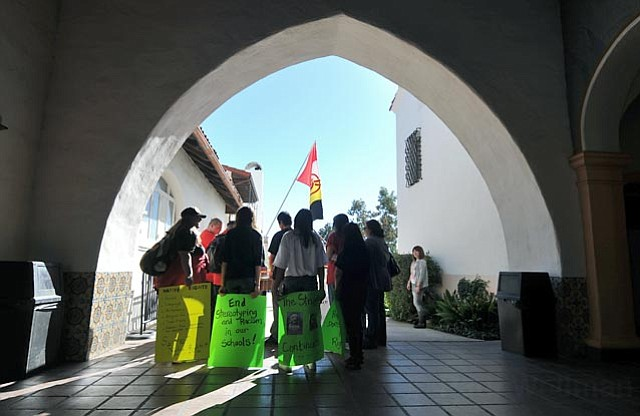 Members of AIM Santa Barbara gather outside the Arlington Theater on MLK Jr. Day