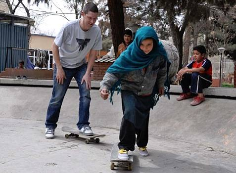 Skateistan founder Oliver Percovich working with Fazila, one of the program's success stories