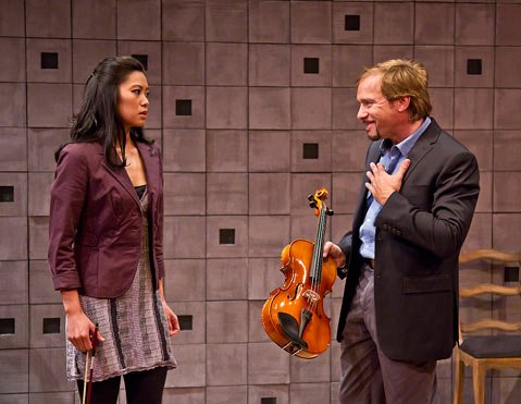 Christine Corpuz plays Grace, the new violist, and Louis Lotorto plays Dorian, the musician she replaces, in the play's Lazara String Quartet.
