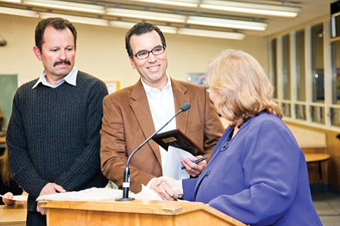 Superintendent Kathy Boomer shakes hands with Allied Waste's general manager Stephen MacIntosh, after presenting him and Juan Villarruel with a plaque thanking the company for their generosity and support to the Goleta Union School District. MacIntosh asked Villarruel, a professional driver for Allied Waste who has collected materials from Goleta schools for many years, to accept the award with him at Wednesday evening's board meeting.