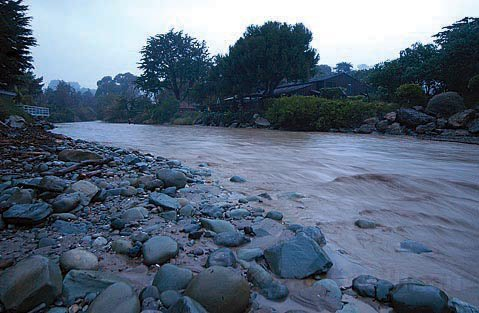 Rincon Creek rages after a heavy rainfall in 2005. Environmental advocates worry that improperly treated wastewater discharge from nearby septic systems is making its way to the ocean, hurting people and the environment.