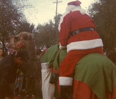 """<strong>CAMEL CHRISTMAS:</strong> Santa Claus greets a crowd on a """"desert reindeer"""" at Wheelus Air Force Base in Libya in 1969."""