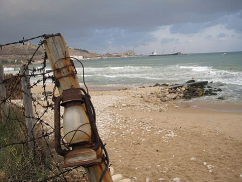 A view from the shores of Jieh, Lebanon, where the oil refinery in the background was bombed in 2006. That made surfing at this beach impossible for a few years.