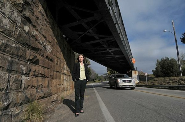 Erika Leachman stands in the bike lane under the Modoc Railroad Bridge.