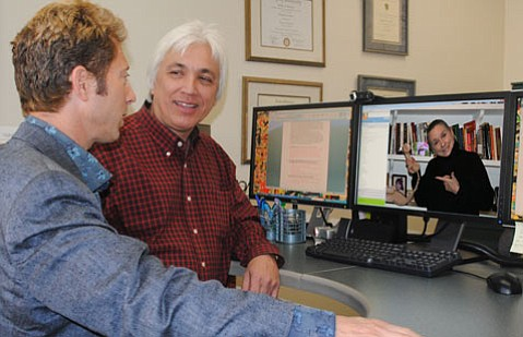 David Wong (center), SBCC's Instructional Technology director, watches as Dr. Doug Hersh, (left), SBCC Educational Programs dean, uses Skype to interact with fellow faculty member Dr. Dixie Budke, SBCC Culinary Arts Department associate professor.