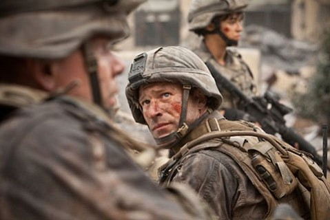<strong>SPACE INVADERS:</strong>  Aaron Eckhart stars as a Marine staff sergeant who must lead his company in a fight against a destructive hoard of alien baddies in <em>Battle: Los Angeles</em>.