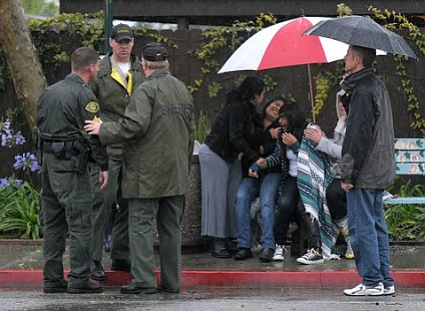 Sheriff's talk while friends and family of victims react to a multi-vehicle crash in Carpintera, Sunday, March 20