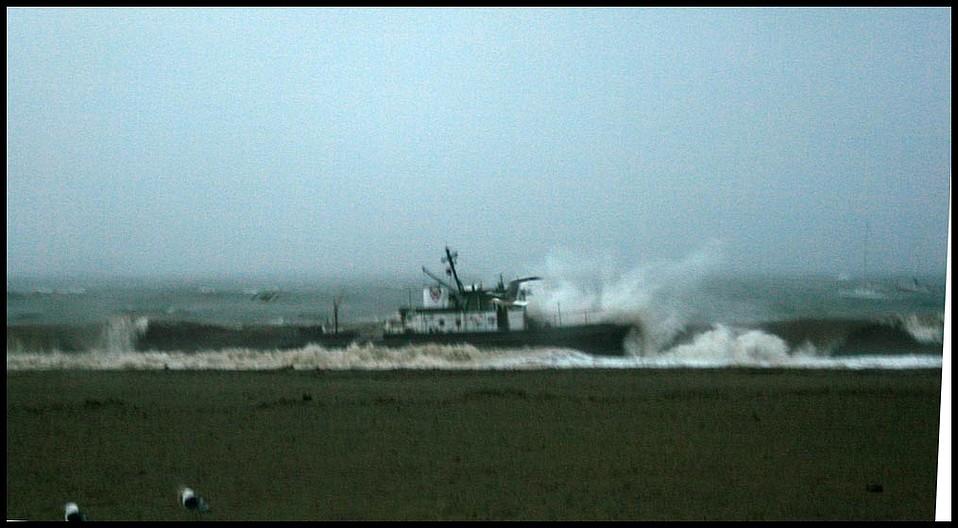Beautiful tugboat hits the beach.