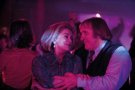 Catherine Deneuve and Gérard Depardieu star in <em>Potiche</em>.