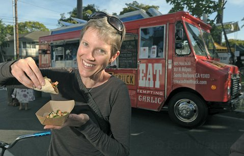 O Street Truck patron Judy enjoys a scrumptious chicken báhn mì taco during S.B.'s 2011 Earth Day Festivities.